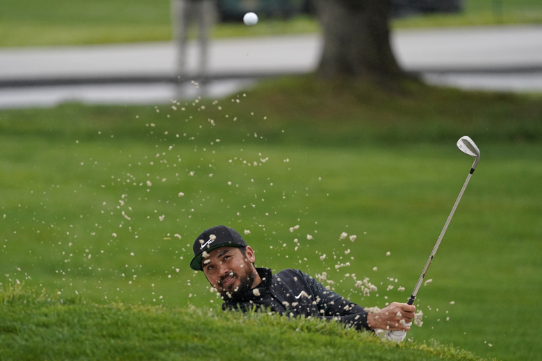 Jason Day, of Australia, follows his shot out of a bunker onto the second green of the Pebble Beach Golf Links during the third round of the AT&T Pebble Beach Pro-Am golf tournament Saturday, Feb. 13, 2021, in Pebble Beach, Calif. (AP Photo/Eric Risberg)