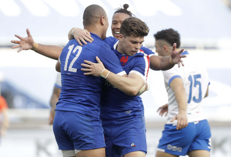 France's Gael Fickou (12) celebrates after scoring his side's second try during the Six Nations rugby union international between Italy and France at Rome's Olympic stadium, Saturday, Feb. 6, 2021. (AP Photo/Gregorio Borgia)
