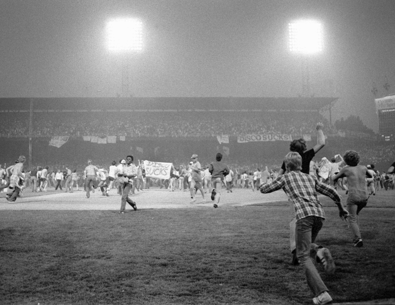 FILE – In this July 12, 1979, file photo, fans storm the field at Chicago's White Sox Park on Disco Demolition night after the first game of a doubleheader between the White Sox and Detroit Tigers. The promotion by a local radio station turned into a melee after hundreds of disco records were blown up on the field. The second game of the doubleheader was called by umpires who declared the field unfit for play. (AP Photo/Fred Jewell, File)