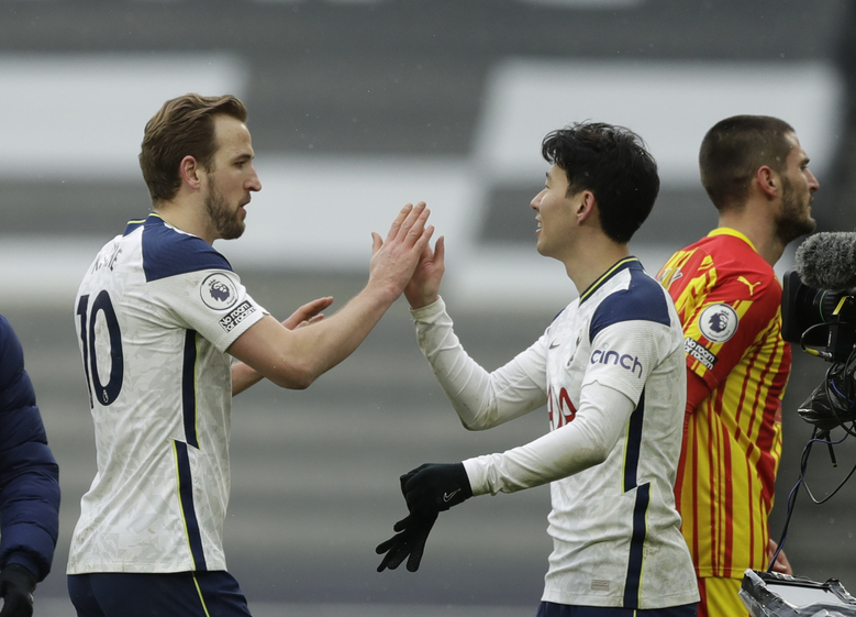 Tottenham's Harry Kane, left, and Tottenham's Son Heung-min celebrate at the end of the English Premier League soccer match between Tottenham Hotspur and West Bromwich Albion at the Tottenham Hotspur Stadium in London, Sunday, Feb. 7, 2021. (AP Photo/Matt Dunham, Pool)