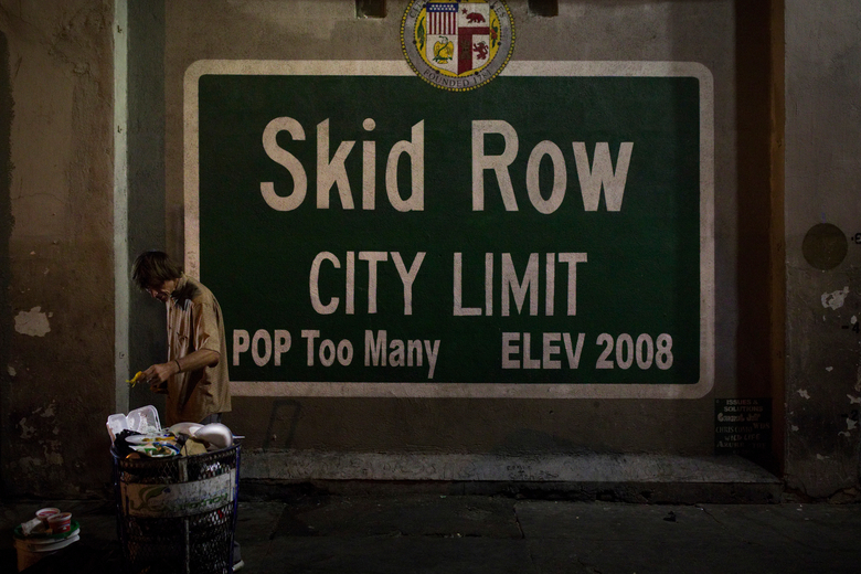 FILE – In this Oct. 28, 2017, file photo, a homeless man takes food from a trash can in Los Angeles' Skid Row area, home to the nation's largest concentration of homeless people in Los Angeles.  California has spent $13 billion in the last three years to tackle a massive homelessness problem likely to worsen with the pandemic, yet its approach is so disjointed and incomplete as to hinder efforts at getting people into stable housing, the state auditor said in a report released Thursday, Feb. 11, 2021. (AP Photo/Jae C. Hong, File)
