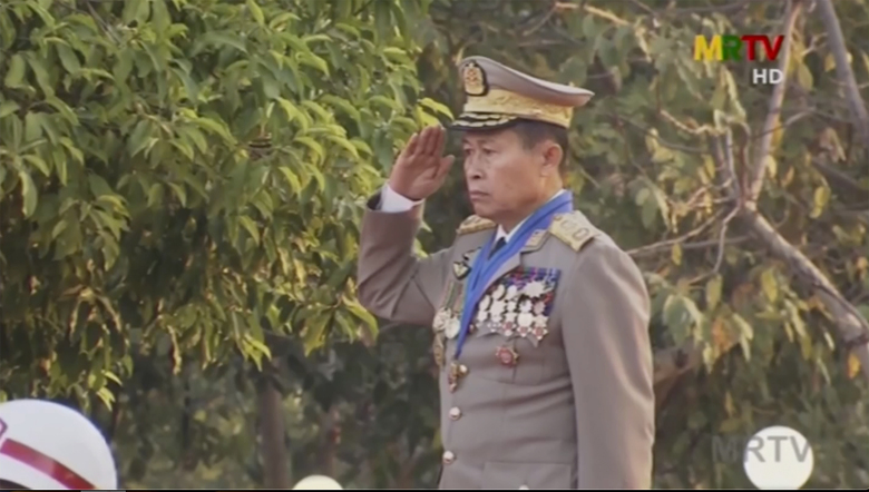 In this image taken from MRTV video, Deputy Commander in chief, Vice Senior Gen. Soe Win salutes during a flag-raising ceremony to mark Union Day in Naypyitaw, Myanmar Friday, Feb. 12, 2021. The Biden administration announced Thursday that new sanctions against Myanmar will target the country's top military officials who ordered this month's coup in the Southeast Asian country. The sanctions name top military commander Min Aung Hlaing and his deputy Soe Win, as well as four members of the State Administration Council. (AP Photo)