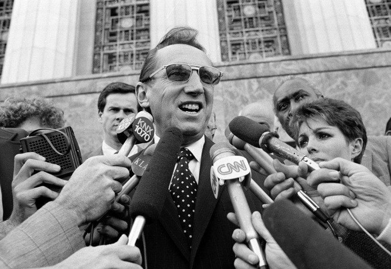 FILE – Los Angeles Raiders' owner Al Davis speaks to the media after a Federal Court jury ruled in favor of the team and the Los Angeles Coliseum in an antitrust suit against the National Football League, in Los Angeles, in this Wednesday, April 14, 1983, file photo. When director Ken Rodgers decided to do a documentary looking back on the battles between late Raiders owner Al Davis and late NFL commissioner Pete Rozelle he decided he wanted to tell the stories from their perspectives. (AP Photo/Nick Ut, File)
