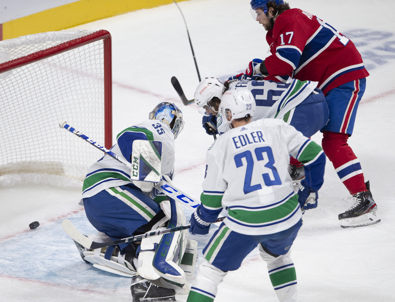 Montreal Canadiens right wing Josh Anderson (17) scores against Vancouver Canucks goaltender Thatcher Demko (35) during the first period of an NHL hockey game Tuesday, Feb. 2, 2021, in Montreal. (Ryan Remiorz/The Canadian Press via AP)