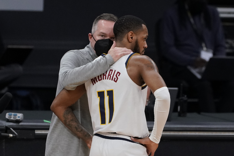 Denver Nuggets coach Michael Malone, left, talks with guard Monte Morris during the first half of an NBA basketball game against the Sacramento Kings in Sacramento, Calif., Saturday, Feb. 6, 2021. (AP Photo/Rich Pedroncelli)