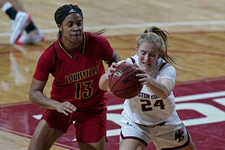 Boston College guard Allie Palmieri (24) controls the ball against Louisville guard Merissah Russell (13) in the second half of an NCAA college basketball game, Thursday, Feb. 4, 2021, in Boston. (AP Photo/Elise Amendola)