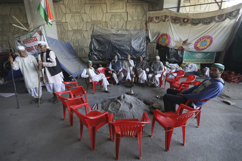 Indian farmers sit at the Delhi-Uttar Pradesh state border as they protest against new farm laws, at Ghazipur, on the outskirts of New Delhi, India, Tuesday, Feb. 23, 2021. Tens of thousands of farmers have camped outside New Delhi for three months to protest new agricultural laws that they say will devastate their livelihood. The protests have posed a major challenge to Prime Minister Narendra Modi's Hindu nationalist government, which says the laws are needed to modernize Indian farming. (AP Photo/Manish Swarup)