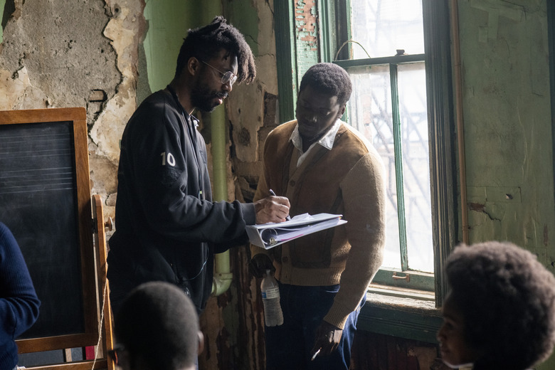 """This image released by Warner Bros. Pictures shows director Shaka King, left, and Daniel Kaluuya on the set of """"Judas and the Black Messiah."""" (Warner Bros. Pictures via AP)"""