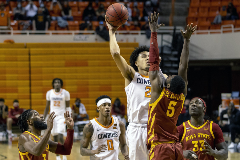 Oklahoma State guard Cade Cunningham (2) shoots over Iowa State guard Jalen Coleman-Lands (5) during the second half of the NCAA college basketball game against in Stillwater, Okla., Tuesday, Feb. 16, 2021. (AP Photo/Mitch Alcala)