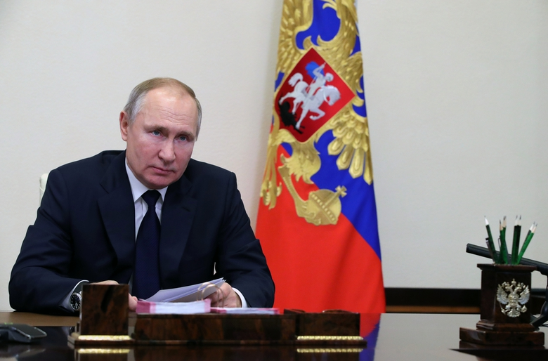Russian President Vladimir Putin attends a meeting with leaders of the State Duma, the Lower House of the Russian Parliament factions via video conference residence at the Novo-Ogaryovo outside Moscow, Russia, Wednesday, Feb. 17, 2021. (Mikhail Klimentyev, Sputnik, Kremlin Pool Photo via AP)
