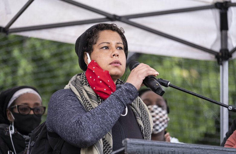Nikkita Oliver addresses a crowd at Cal Anderson Park in June. Oliver is seeking a seat on the Seattle City Council in this fall's election. (Dean Rutz / The Seattle Times, file)