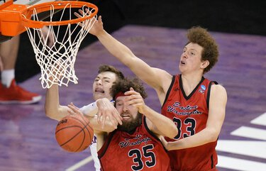 Kansas guard Christian Braun, left, battles Eastern Washington forward Tanner Groves (35) and teammate Jacob Groves (33) for a rebound during the second half of a first-round game in the NCAA college basketball tournament at Farmers Coliseum in Indianapolis, Saturday, March 20, 2021. (AP Photo/AJ Mast) INSH113 INSH113
