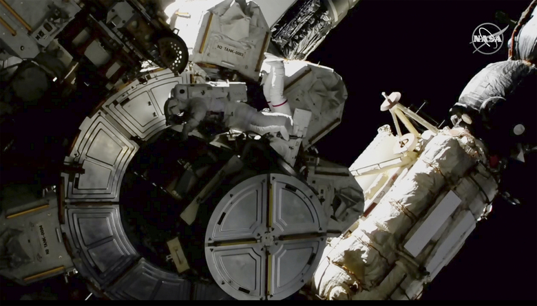 In this image provided by NASA shows NASA astronauts Victor Glover and Mike Hopkins on a spacewalk outside the International Space Station on Saturday, March 13, 2021.  The astronauts are rearranging space station plumbing and tackling other odd jobs. The work should have been completed a week ago, but power upgrades took longer than expected. (NASA via AP)