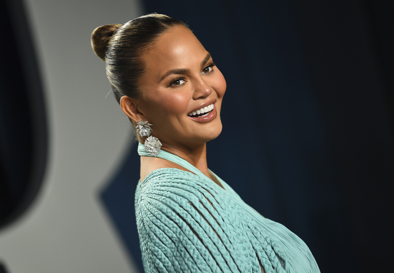 """Chrissy Teigen, seen in 2020, will grace the front of People magazine's """"The Beautiful Issue"""" in a cover story that delves into her evolved definition of beauty, facing racism growing up and her heartbreaking miscarriage last year. The magazine revealed the cover Wednesday, which hits newsstands Friday. (Evan Agostini / Invision/AP, file)"""