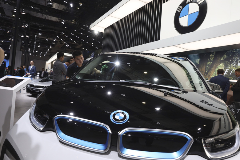 FILE – In this Wednesday, April 17, 2019 file photo, a worker cleans an electric vehicle at the BMW booth during the Auto Shanghai 2019 show in Shanghai. Automakers BMW and Volvo announced Wednesday, March 31, 2021 that they support a moratorium on deep sea mining for minerals used in electric vehicle batteries. The call was also backed by Samsung's EV battery unit and tech giant Google. (AP Photo/Ng Han Guan, file)