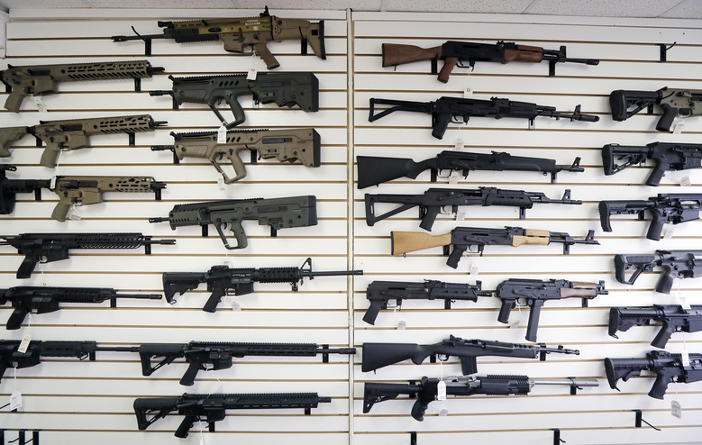 Semi-automatic rifles fill a wall at a gun shop in Lynnwood, Wash., in 2018. Mass shootings in Georgia and Colorado in March 2021 have reignited calls from gun control advocates for tighter restrictions on buying firearms and ammunition. But gun rights advocates have been persuading Republican-run state legislatures to go the other way, making it easier to obtain and carry guns. (AP Photo/Elaine Thompson, File)