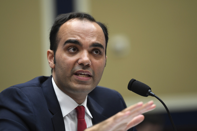 FILE – In this May 8, 2019 file photo, then Federal Trade Commission commissioner Rohit Chopra testifies during a House Energy and Commerce subcommittee hearing on Capitol Hill in Washington.  Chopra, President Joe Biden's nominee to run the federal consumer watchdog agency is likely to be face hostile questioning from Republican Senators on Tuesday, March 2, 2021,  but is likely to be confirmed with Democrats controlling a majority in the Senate.  (AP Photo/Susan Walsh)