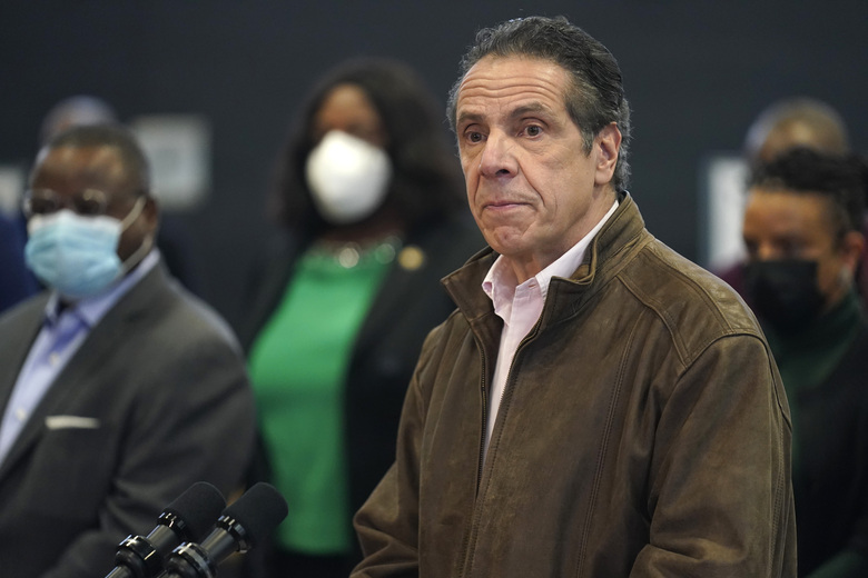 New York Gov. Andrew Cuomo on Feb. 22 pauses to listen to a reporter's question during a news conference at a COVID-19 vaccination site in the Brooklyn borough of New York. New York's attorney general said she's moving forward with an investigation into sexual harassment allegations against the governor after receiving a letter from his office Monday authorizing her to take charge of the probe. (AP Photo/Seth Wenig, Pool, file)