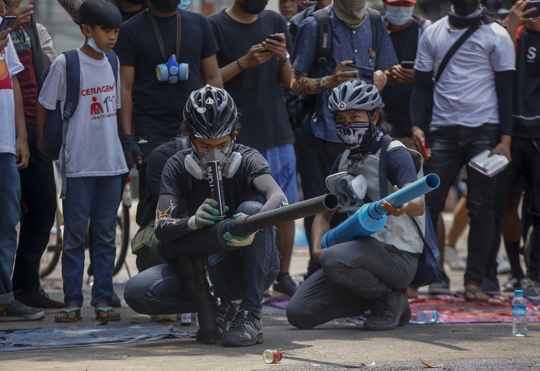 Anti-coup protesters test improvised weapons made to fight with government security forces in Yangon, Myanmar, Wednesday, March 17, 2021. (AP Photo)