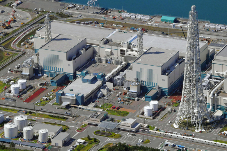 FILE – This Sept. 30, 2017, aerial file photo shows the reactors of No. 6, right, and No. 7, left, at Kashiwazaki-Kariwa nuclear power plant, on the northern Japanese coast in Niigata prefecture. Japanese nuclear regulators said Wednesday, March 17, 2021 that the world's largest nuclear power plant, owned by the utility behind the Fukushima nuclear crisis, will not restart anytime soon due to serious holes in the anti-terrorism measures found at the facility. The Nuclear Regulation Authority at its weekly meeting decided to suspend further safety inspection and other processes for a restart of the No. 7 reactor at the plant. (Kyodo News via AP, File)