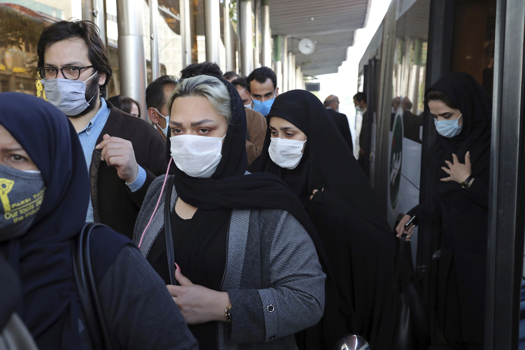 FILE – In this Oct. 11, 2020, file photo, people wear protective face masks to help prevent the spread of the coronavirus in downtown Tehran, Iran. Iran's campaign to inoculate its population against the coronavirus and promote itself as an emerging vaccine manufacturer inched on as health authorities announced Tuesday, March 16, 2021, that the country's third homegrown vaccine has reached the phase of clinical trials. (AP Photo/Ebrahim Noroozi, File)