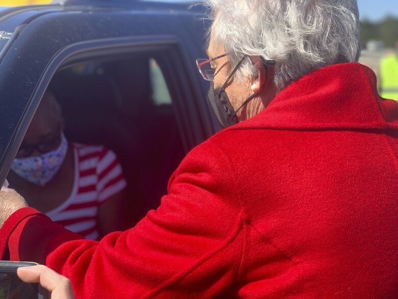 In Alabama, which has struggled to work through its vaccine supplies, Gov. Kay Ivey hands a vaccination sticker to Doris Coleston after Coleston received a COVID-19 shot on April 2.  (Kim Chandler / The Associated Press)