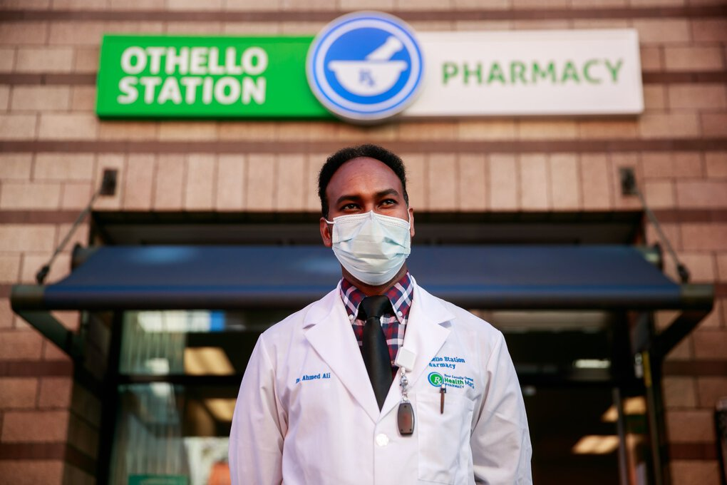 Pharmacist Ahmed Ali established the Othello Station Pharmacy with Abdirahman Tache. A Somali refugee who moved to the neighborhood in 1997, He wanted to give back to his community as a health professional, and when he graduated from the Washington State University's pharmacy program in 2008, he vowed to create a space for young people of color to seek inspiration. (Erika Schultz / The Seattle Times)