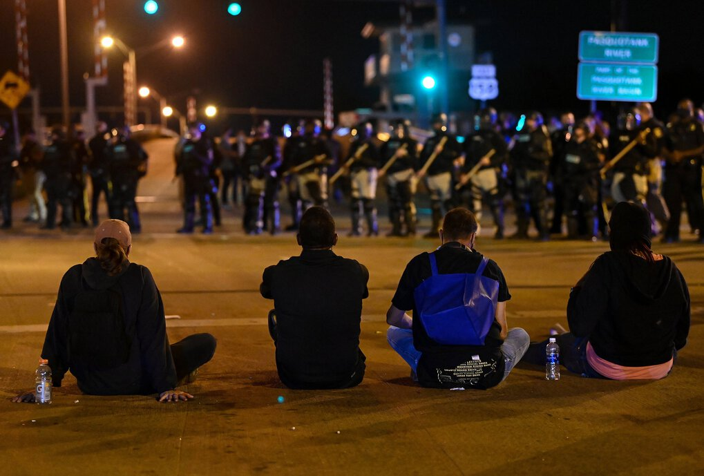 Protesters face a line of police officers on Tuesday, April 27, in Elizabeth City, N.C. (Joshua Lott / The Washington Post)