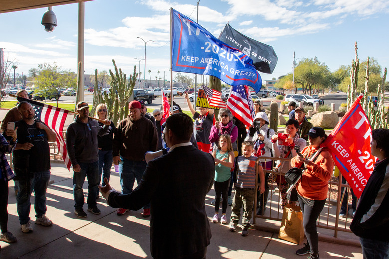 People in Phoenix protest the presidential election results in December 2020. (Courtney Pedroza / The Washington Post).
