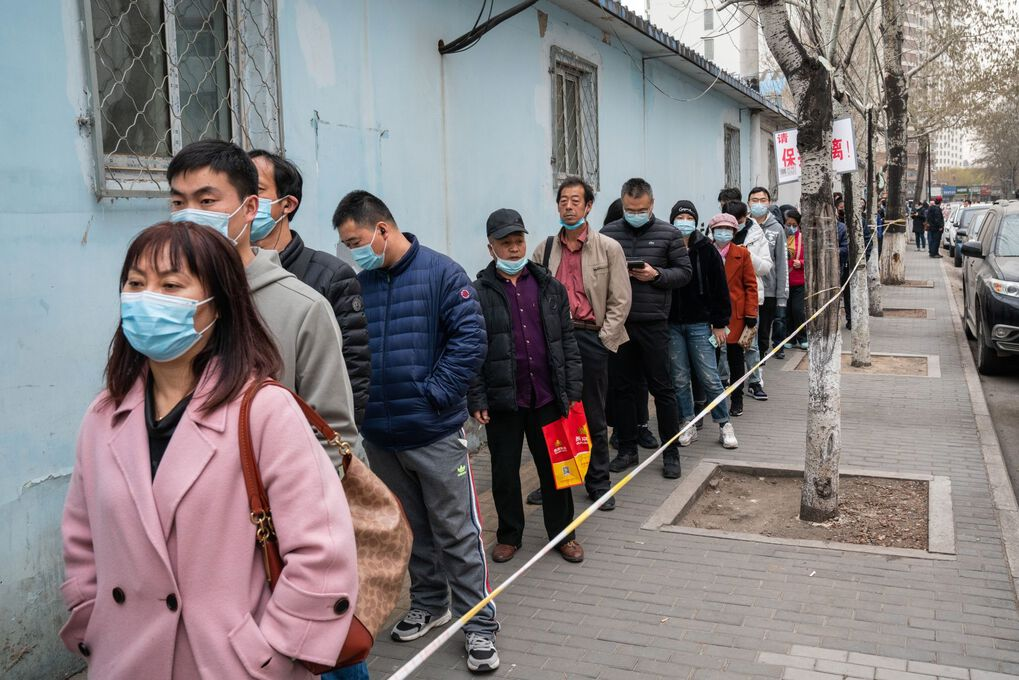 People wait in line outside a Covid-19 vaccination center in Beijing, China, on Wednesday, March 17, 2021. The Chinese capital city is offering Covid vaccine shots to people aged 60 and above who are in good heath, Beijing Center for Disease Prevention and Control said in a statement. Photographer: Yan Cong/Bloomberg (Bloomberg)
