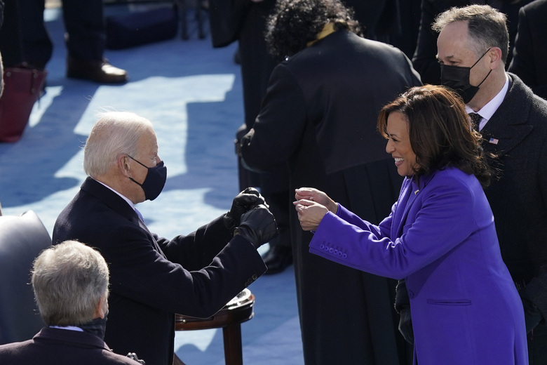 FILE – In this Jan. 20, 2021, file photo President-elect Joe Biden congratulates Vice President Kamala Harris after she was sworn in during the 59th Presidential Inauguration at the U.S. Capitol in Washington. Biden will mark his 100th day in office on Thursday, April 29. (AP Photo/Carolyn Kaster, File)