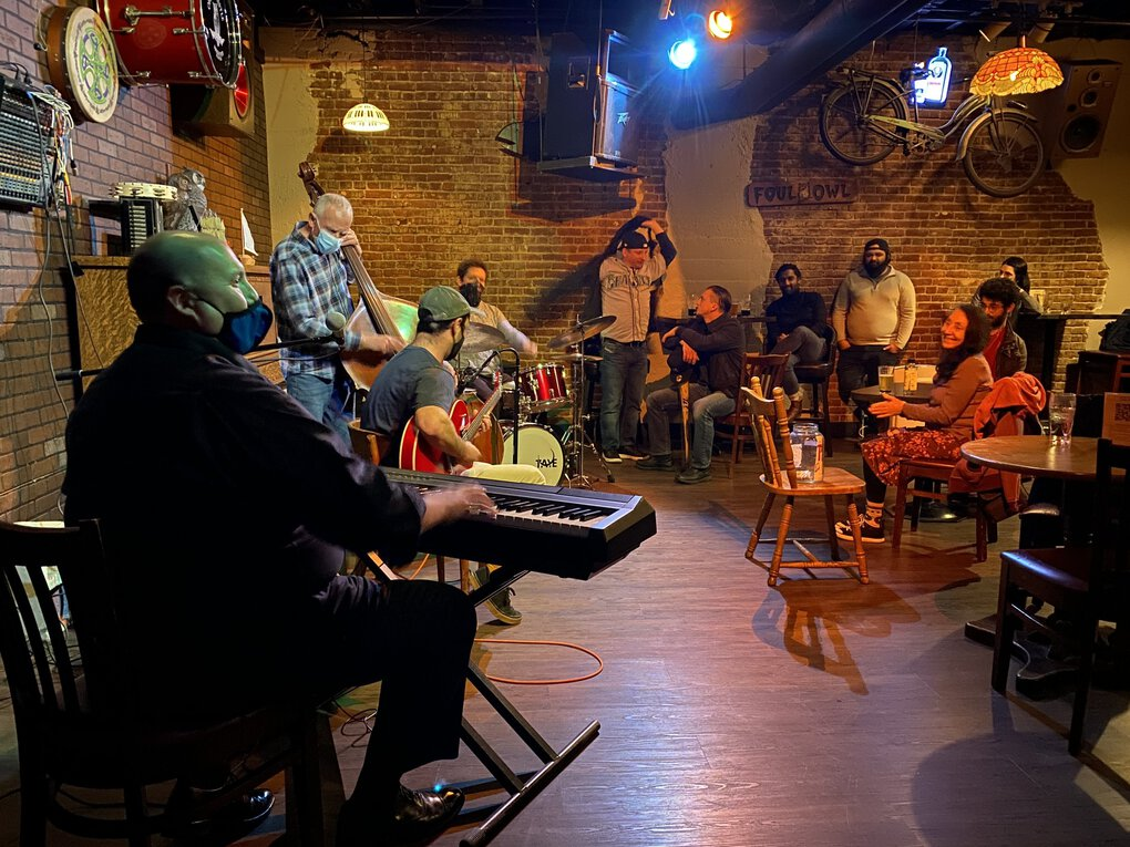 After getting fully vaccinated, veteran pianist Eric Verlinde (front left on keys) resumed organizing a long-running jazz jam at the Owl N' Thistle bar in Pioneer Square. (Michael Rietmulder / The Seattle Times)