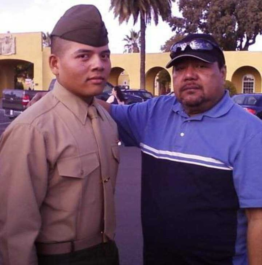 Lance Cpl. Ramon Taisakan Kaipat, left, with his dad Pedro S. Kaipat after graduating from boot camp in California in 2008. (Courtesy of the Kaipat family)