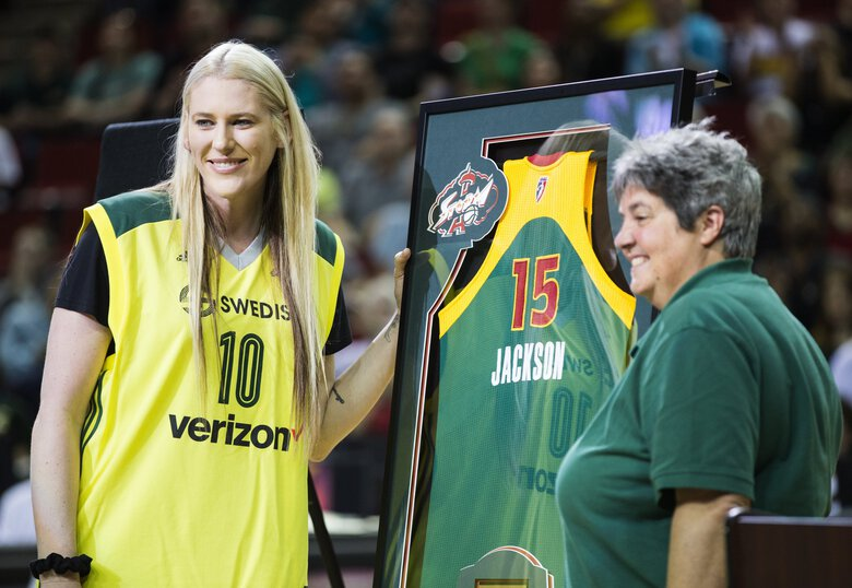 Lauren Jackson is presented with her jersey by Storm co-owner Lisa Brummel during a postgame ceremony  honoring Lauren Jackson at KeyArena on Friday, July 15, 2016.  (Lindsey Wasson / The Seattle Times)