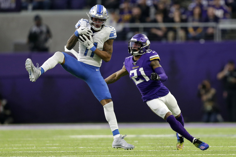 File-This Dec. 8, 2019, file photo shows Detroit Lions wide receiver Marvin Jones catching a pass ahead of Minnesota Vikings cornerback Mike Hughes, right, during the first half of an NFL football game, in Minneapolis. The Vikings have declined the fifth-year contract option for Hughes. The 2018 first-round pick has missed more than half of the games to injuries since he was drafted. Neck trouble that first occurred in 2019 continued last season and limited him to four games.  (AP Photo/Andy Clayton-King, File)