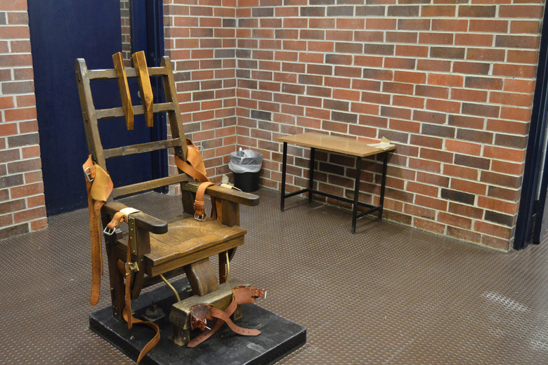 FILE –  This March 2019, file photo, provided by the South Carolina Department of Corrections shows the state's electric chair in Columbia, S.C. South Carolina Gov. Henry McMaster signed into law last week a bill that would essentially restart the state's stalled death penalty after a lack of lethal injection drugs has delayed several executions. The new law would let condemned inmates choose between the electric chair or a newly formed firing squad. (Kinard Lisbon/South Carolina Department of Corrections via AP, File)