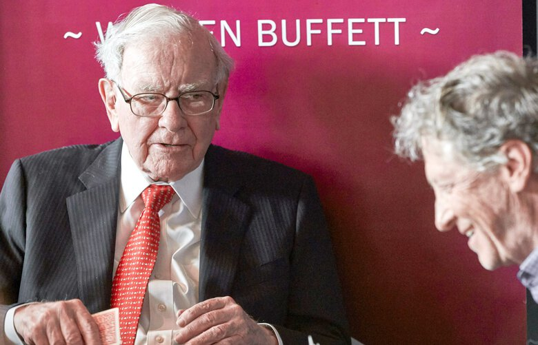 Warren Buffett, Chairman and CEO of Berkshire Hathaway, left, addresses Gill Gates, right, during a game of bridge following the annual Berkshire Hathaway shareholders meeting in Omaha, Neb., Sunday, May 5, 2019. (AP Photo/Nati Harnik) NENH106