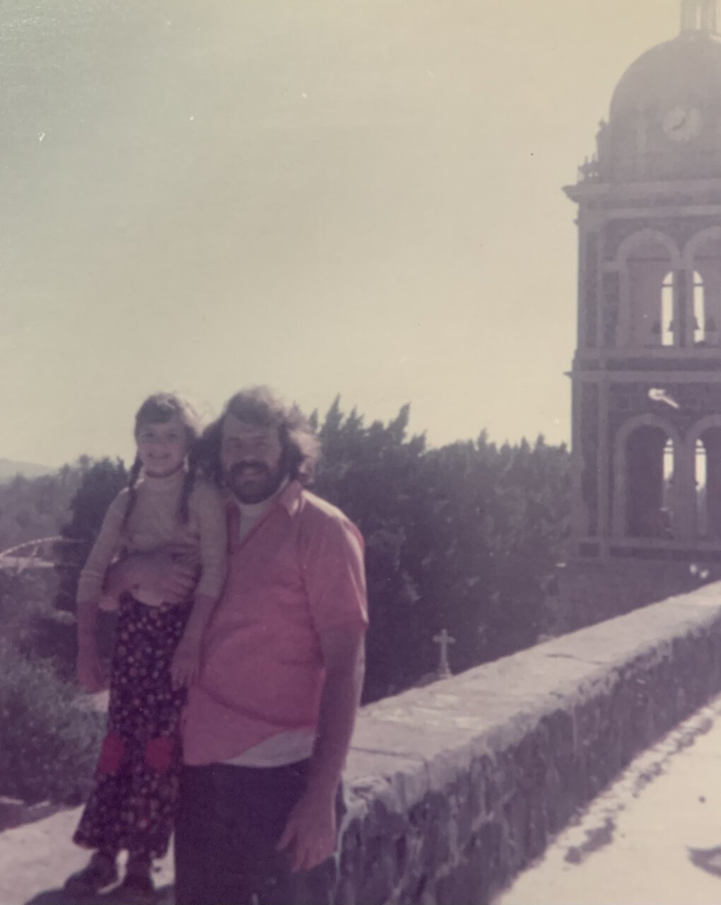 Angela Cragin, pictured here with her father George Bakan while on vacation in Mexico as a child, was surprised to find that Bakan had left the Seattle Gay News to her after his death. (Courtesy of Angela Cragin)