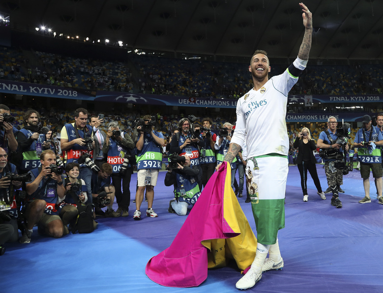 FILE – In this May 27, 2018 file photo, Real Madrid's Sergio Ramos celebrates after winning the Champions League Final soccer match between Real Madrid and Liverpool at the Olimpiyskiy Stadium in Kiev, Ukraine. An emotional Sergio Ramos said goodbye to Real Madrid on Thursday, saying he wanted to stay but the club preferred not to renew his contract. (AP Photo/Sergei Grits, File)