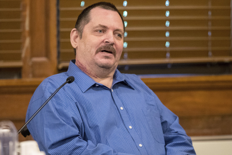 FILE – In this July 9, 2019, file photo, Aubrey Trail testifies during his murder trial at the Saline County Courthouse in Wilber, Neb. Trail was sentenced to death Wednesday, June 9, 2021, for killing and dismembering a Nebraska hardware store clerk who refused to commit to his lifestyle of group sex and fraud. (Chris Machian/Omaha World-Herald via AP, File)