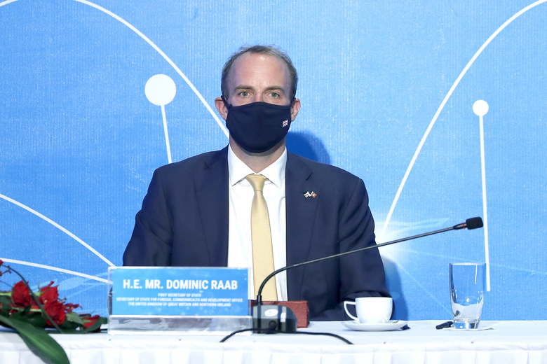 """Britain's Foreign Secretary Dominic Raab participates in a meeting in Hanoi, Vietnam, Tuesday, Jun. 22, 2021. Foreign ministers of Britain, Singapore, South Korea and Vietnam join with the rest of the ASEM delegates attending virtually via video conferencing to discuss cooperation between """"Asia and Europe partnership in a changing world."""" (AP Photo/Hau Dinh)"""