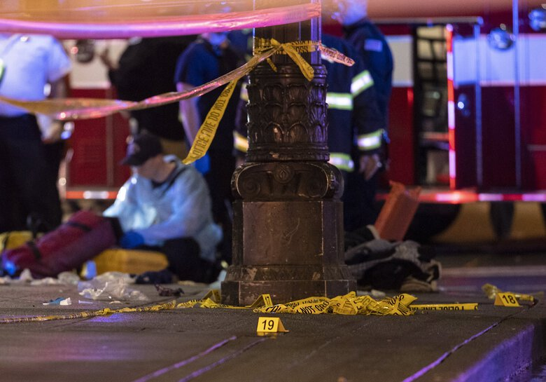 Police work a crime scene after a shooting near Third Avenue and Pine Street in downtown Seattle in 2020. New data shows Washington state set a record for homicides last year, topping the previous high set in 1994. (Amanda Snyder / The Seattle Times)
