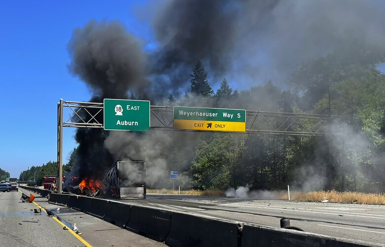 Both directions of highway 18 in Federal Way were shut down after a fiery crash Tuesday afternoon. All occupants were safe, according to South King Fire & Rescue. (South King Fire & Rescue)