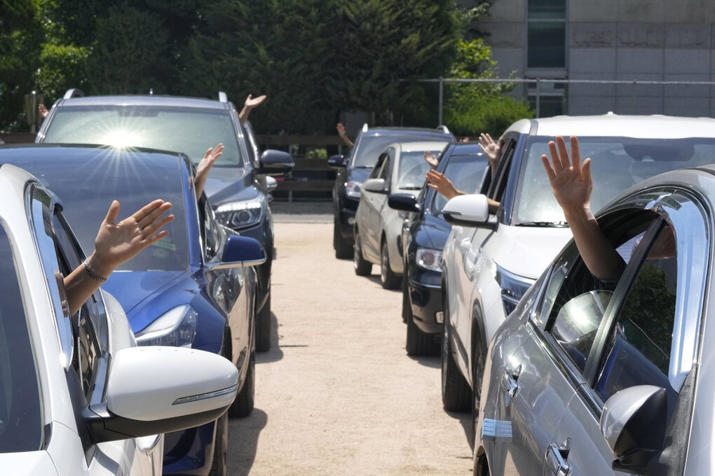 People pray inside their cars during a drive-in church service amid measures to help prevent the spread of the coronavirus at the Songgok high school in Seoul, South Korea, Sunday, July 25, 2021. (Ahn Young-joon / The Associated Press)