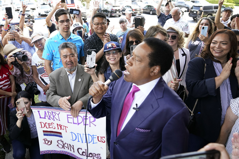"""FILE – In this July 13, 2021, file photo, conservative radio talk show host Larry Elder speaks to supporters during a campaign stop in Norwalk, Calif. Elder has filed a lawsuit Monday, July 19, 2021, challenging a decision by California election officials to block him from running in the state's Sept. 14 recall election, saying he's the target of political """"shenanigans"""" by Sacramento Democrats. (AP Photo/Marcio Jose Sanchez, File)"""