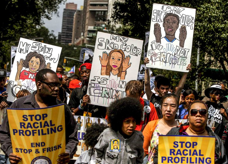 """File-This photo from Sunday, June 17, 2012, shows protestors with signs during a silent march to end """"stop-and-frisk"""" program in New York. Eight years after a judge ruled New York City police violated the constitution by stopping and frisking mostly Black and Hispanic people on the street en masse, people in communities most affected by such tactics say they've been shut out of the legal process to end them. (AP Photo/Seth Wenig, File)"""