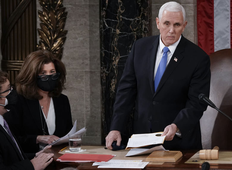 FILE – In this Jan. 6, 2021, file photo, Senate Parliamentarian Elizabeth MacDonough, second from left, works beside Vice President Mike Pence during the certification of Electoral College ballots in the presidential election, in the House chamber at the Capitol in Washington. Shortly afterward, the Capitol was stormed by rioters determined to disrupt the certification. (AP Photo/J. Scott Applewhite, File)