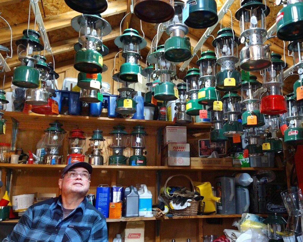 Ron Judd with part of his collection of working vintage Coleman lanterns. (Meri-Jo Borzilleri)