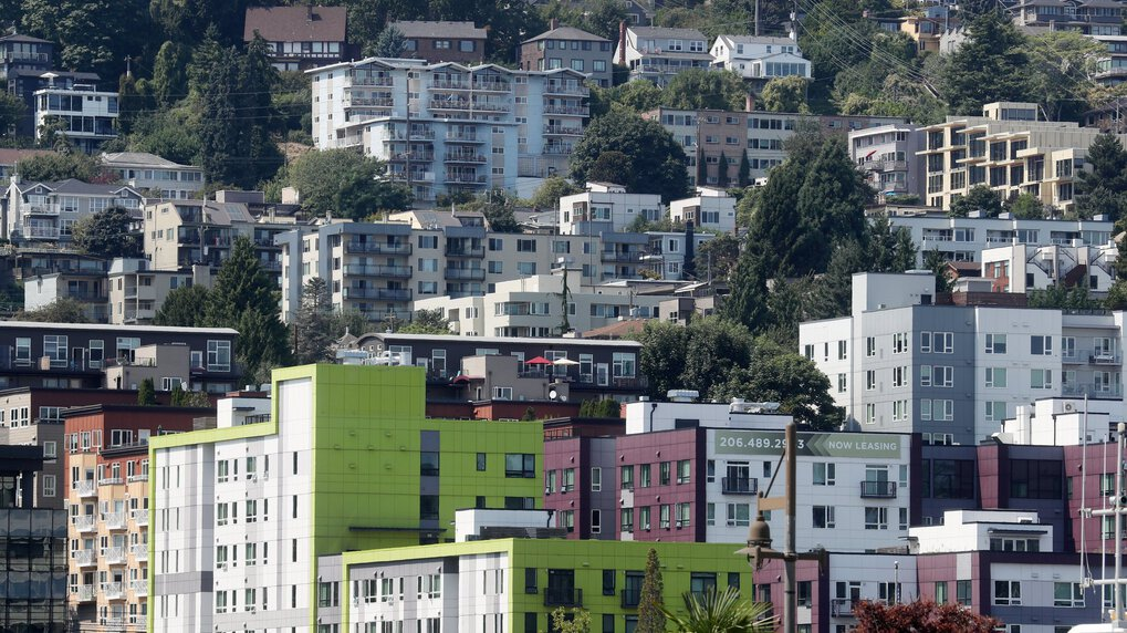Rental apartments in the Westlake neighborhood merge with Queen Anne single-family homes above, seen from Lake Union on Sunday in Seattle. (Ken Lambert / The Seattle Times)