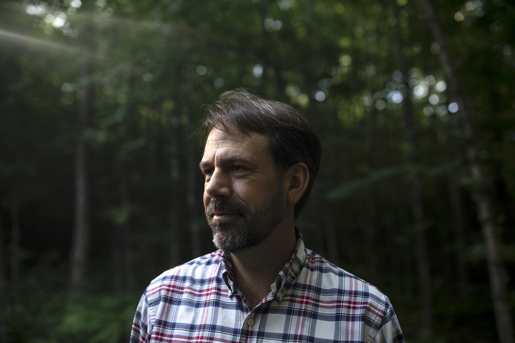 Sean Clouston, an epidemiologist and professor of public health at Stony Brook University, has been studying the effects of 9/11 on the brains of first responders. He is photographed in Readfield, Maine, on Aug. 15, 2021. (Photo for The Washington Post by Briana Soukup)